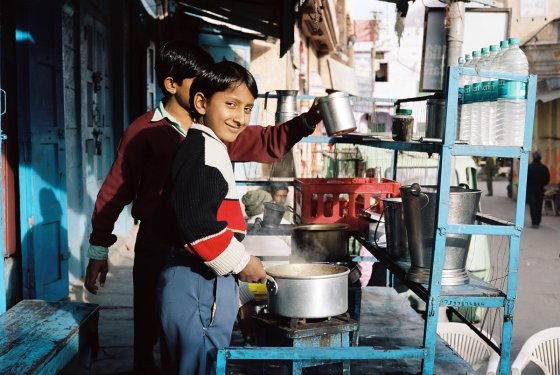 A boy running a masala chai stand in Pushkar.
